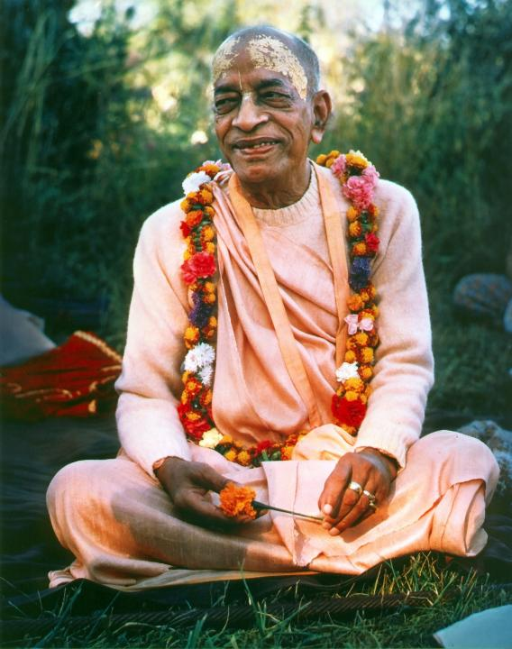 Prabhupada Sitting on Grass and Smiling