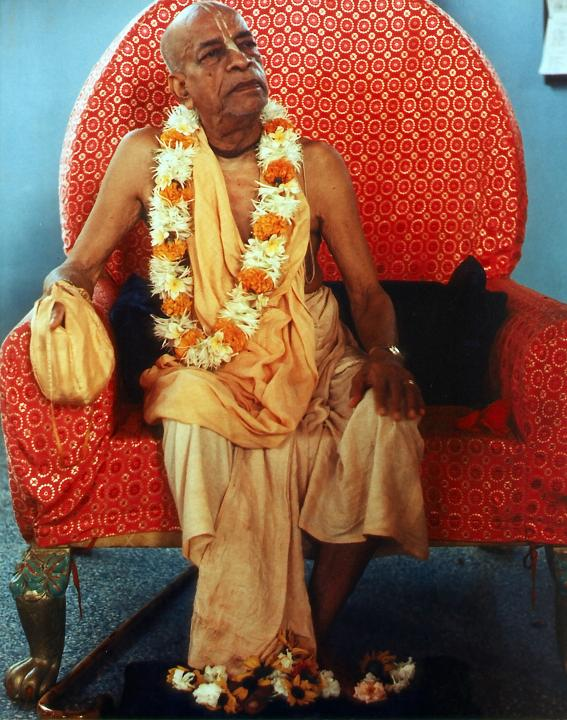 Srila Prabhupada Sitting Chanting Hare Krishna on Japa Beads